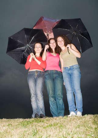 three girls with colored umbrellas Stock Photo - 1478720