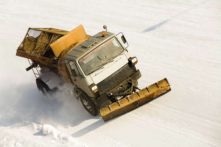 snow buldoser on the road photo