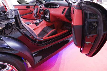 beautiful red car with opened door