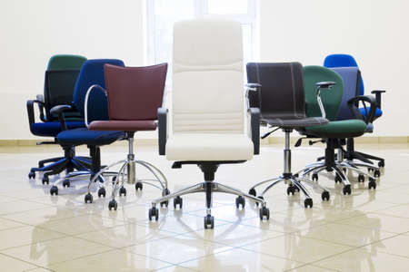 trundle: directors armchair and other in empty room Stock Photo