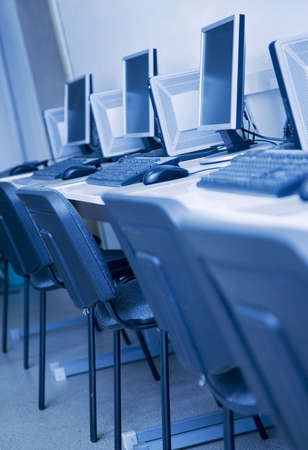 hall monitors: a lot of computers in a learning class Stock Photo