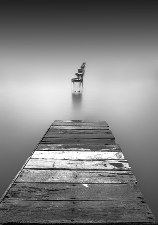 seascapes: Minimalist of A Wooden Jetty Stock Photo