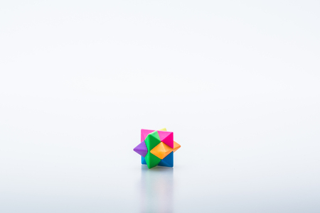Colourful 3D puzzle piece isolated on white background. Concept of puzzle solving. Isolated on white background. Slightly de-focused and close-up shot. Copy space. 版權商用圖片