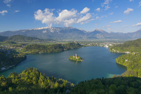 Panoramic view of Lake Bled from Little Osojnica Hill, at sunny day with beautiful clouds on background, Slovenia Stock Photo