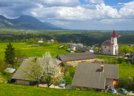 Rural alpine landscape with slovenian village in valley near Bled lake at spring sunny day Stock Photo