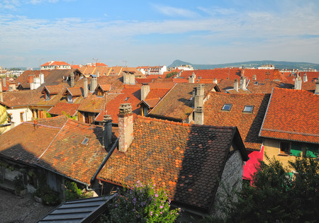 Roofs of medieval buildings at sunny summer day in Annecy, France Stock Photo