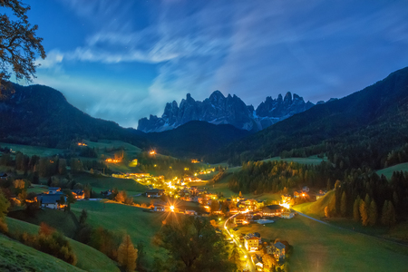Amazing night scenery of Santa Maddalena village before sunrise. Mountain peaks and picturesque sky on background at twilight. Dolomite Alps, South Tyrol, Italy.