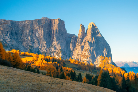 Amazing morning view on Schlern - Sciliar mountain and Seiser Alm - Alpe di Siusi. Beautiful autumn scenery in Dolomite Alps, South Tyrol, Italy.