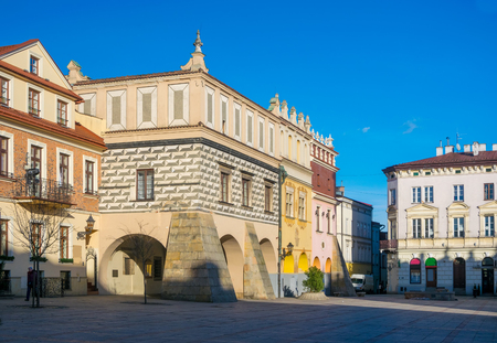 Scenic view of renaissance tenement houses on market square of old town in Tarnow, Poland at sunny day