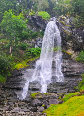 Scenic view of Steinsdalsfossen waterfall, Western Norway. Travel destination scene