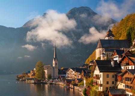 Scenic view of famous Hallstatt mountain village in the Alps under picturesque clouds at autumn morning, Hallstatt-Dachstein, Salzkammergut, Upper Austria