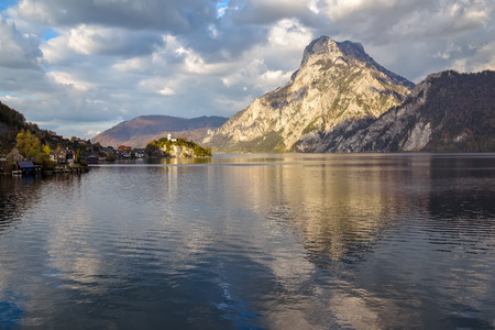 Scenic view of Lake Traunsee with Johannesberg Chapel, Traunkirchen and sunlit mountains under picturesque clouds reflected in the water, Salzkammergut, Upper Austria, Austria, Europe Reklamní fotografie