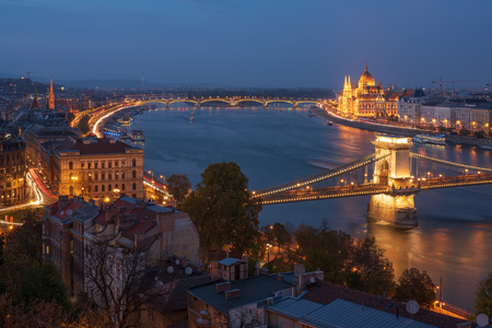 Scenic view of Budapest city at blue hour with illuminated Chain Bridge, Hungarian Parliament, Margaret Bridge and Danube embankment. Picturesque evening cityscape.
