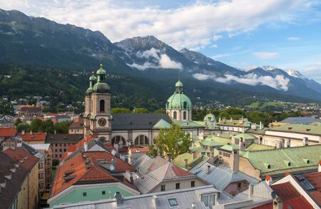 Aerial view of Cathedral of St. Jacob - Dom - and roofs of Imperial Palace - Hofburg - in old city of Innsbruck, Alps mountains in background taken from town hall tower, Tirol, Austria Reklamní fotografie