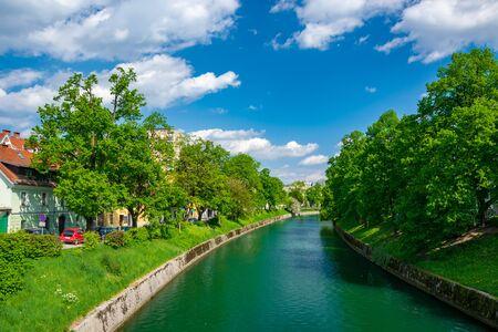 Scenic view of Ljubljanica river in the historical center of Ljubljana, Slovenia at sunny spring day Stock Photo