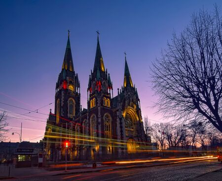 Nightscape of gothic Church of Sts. Olha and Elizabeth in Lviv, Ukraine with autotracks at twilight. Special art effect