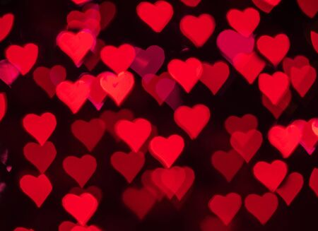 Red hearts bokeh as background for Valentines day