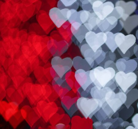 Red and white hearts bokeh as background for Valentines day