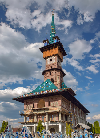 Traditional maramures neo-gothic church on Merry Cemetery in Sapanta village, Romania