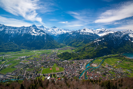 Breathtaking aerial view over Interlaken and Swiss Alps from Harder Kulm View point. Interlaken - popular travel destination in Swiss Alps, Berner Oberland, Switzerland