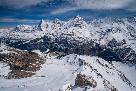Breathtaking panoramic view of snow capped Swiss Alps with famous peaks Eiger, Monch and Jungfrau, Berner Oberland, Switzerland