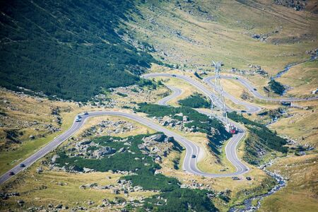 Scenic view of Transfagaras mountain road, Romania. One of the windiest roads in the world is the Transfagaras highway crossing the Fagaras Mountains in Romania