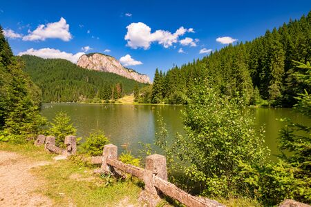Summer scenery of mountain lake Lacul Rosu (Red Lake or Killer Lake). Popular travel destination and place for active rest and adventures in Eastern Carpathians. Harghita County, Romania