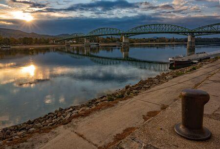 Scenic view of Maria Valeria bridge with reflection in Danube river on Slovak-Hungary border at sunrise. Esztergom, Hungary. Travel destination 스톡 콘텐츠