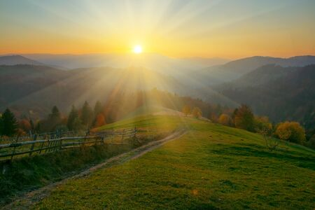 Colorful autumn and scenic sunrise in the Carpathian mountains. Stock Photo