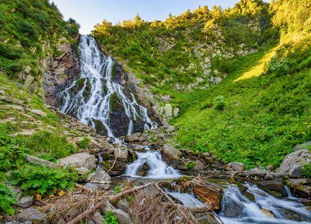 Majestic view of Balea Cascada waterfall in Fagaras mountains near famous Transfagarasan road. Rocky waterfall in the Carpathians, Transylvania, Romania Stockfoto