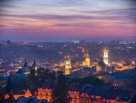 Amazing panoramic view of Dominican and Carmelite Monastery, Korniakt Tower, City Hall Tower, Latin Cathedral in historical city center at twilight, Lviv, Ukraine. UNESCO world heritage site 스톡 콘텐츠