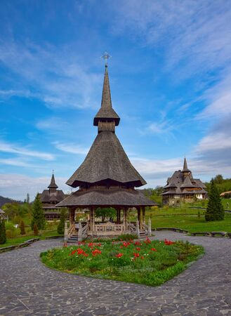 Traditional Maramures wooden architecture of Barsana monastery, Romania. Picturesque sky 스톡 콘텐츠
