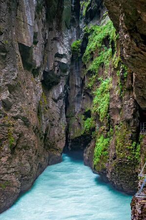 Stunning view inside the Aare Gorge at a narrow point. Hasli valley near Meiringen, Canton Bern, Switzerland. Aare Gorge (Aareschlucht) is popular tourist attraction in Berner Oberland