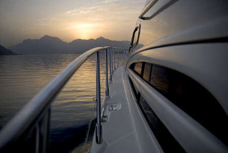 On A Yacht Heading To The Mountains Stock Photo