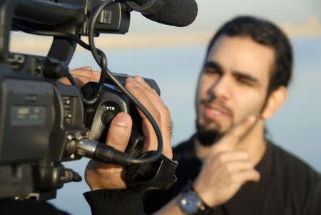 filming: Cameraman & Host Stock Photo