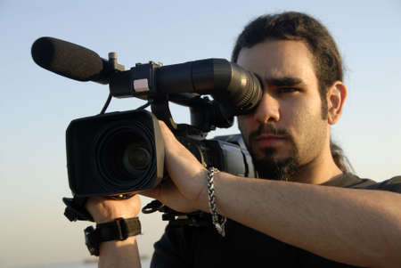 A Professional Cameraman Filming Footage On Location
