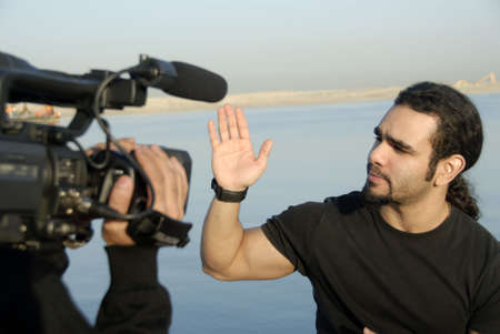 Actor Explaining Convincingly With Hand Gestures During For Realtime Broadcast photo