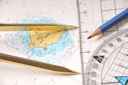 Measuring Distance On A Map With A School Compass Stock Photo