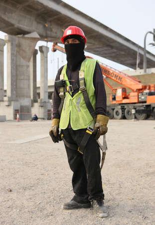 cid: Dubai Metro Construction Worker Stock Photo
