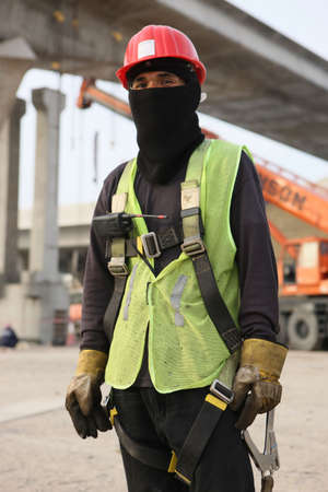 Immigrant Asian Construction Worker In A Construction Zone photo