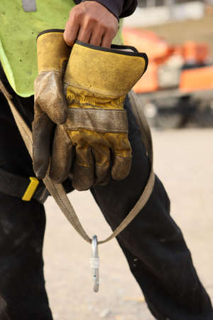 drudgery: Construction Worker Takes Off Gloves After A Days Work