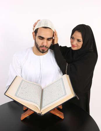 Arabic Loving Wife Adjusts Husbands Prayer Cap As He Recites The Holy Quran