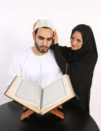 Arabic Loving Wife Adjusts Husbands Prayer Cap As He Recites The Holy Quran