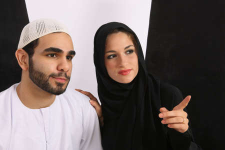 sunni: Emirati Arabian Married Couple Looking In Amusement