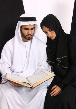 Arabian Couple Reading The Quran