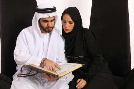 Arab Man Translating Islamic Text To His Wife