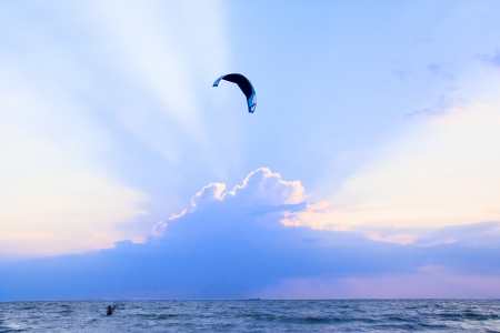 Kite- surfing at sunset in the Sea of Azov photo