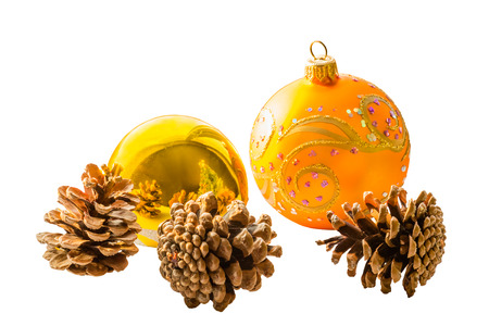 pine three: Two Christmas balls and three pine cones isolated on white background Stock Photo