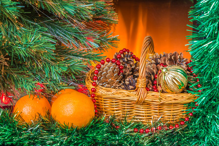 New year composition with oranges and basket near the fireplace photo