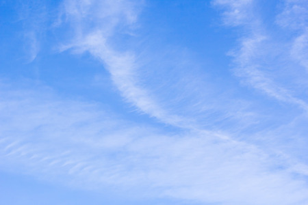 cirrus clouds: Blue sky with delicate arabesques of white cirrus clouds Stock Photo